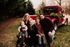 Marshall family in front of a red truck