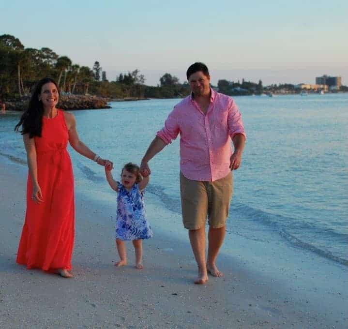 Laura Sargent and family walking on the beach