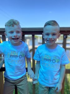 Jackson and his twin brother, Grady, holding hands