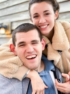 Teen sibling and her brother with Angelman syndrome